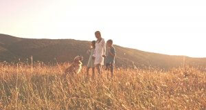 Mom, Kids and Dog out in Sunny Field